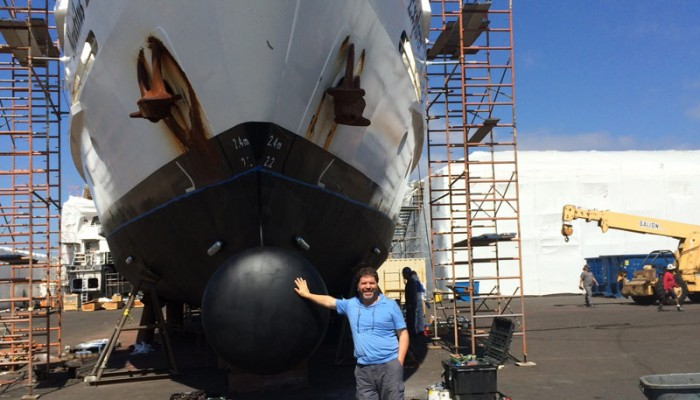 Captain Mike standing infront of the Nautilus Explorer