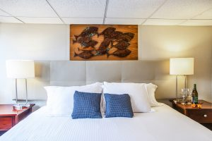 Enjoy our large, comfortable bed in the Emerald Suite on the Nautilus Explorer