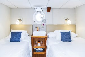 Two comfortable beds in a Nautilus Explorer statetroom