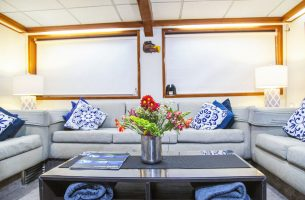 Comfy couches welcome you onboard the Nautilus Explorer in the lounge area